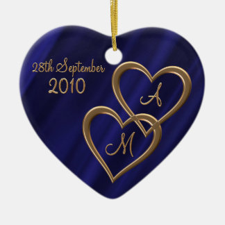Two entwined gold hearts ceramic ornament
