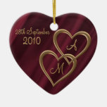 Two entwined gold hearts ornaments