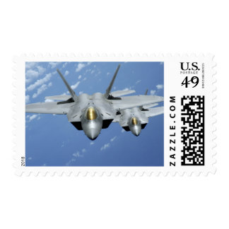 Two F-22 Raptors fly over the Pacific Ocean 2 Postage