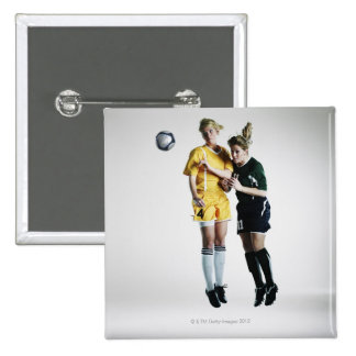 Two female soccer players in mid air heading 2 inch square button