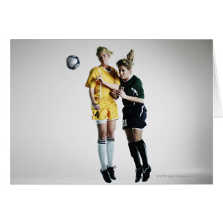 Two female soccer players in mid air heading greeting cards