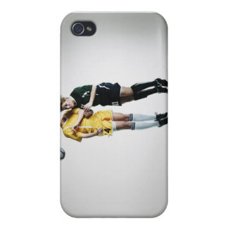 Two female soccer players in mid air heading covers for iPhone 4