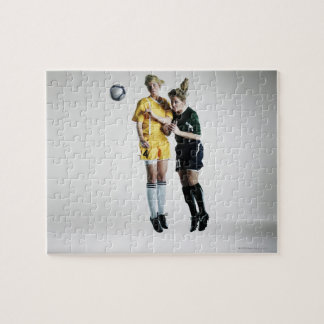 Two female soccer players in mid air heading jigsaw puzzle