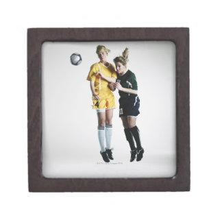 Two female soccer players in mid air heading premium keepsake box