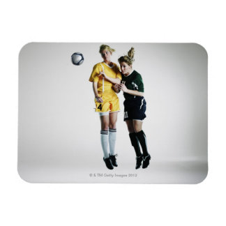 Two female soccer players in mid air heading rectangular photo magnet