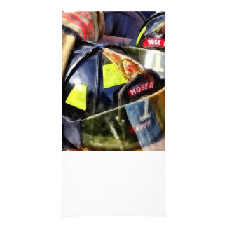 Two Fire Helmets And Fireman's Jacket Card