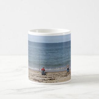 Two Fishermen on the beach Mug