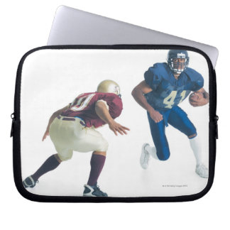 two football players from opposing teams are laptop sleeve