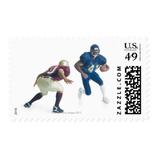 two football players from opposing teams are postage