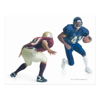 two football players from opposing teams are postcard