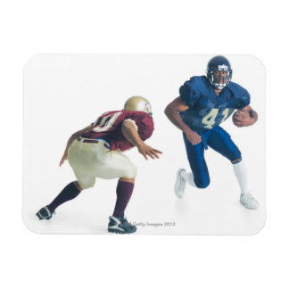 two football players from opposing teams are rectangular photo magnet