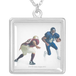 two football players from opposing teams are silver plated necklace