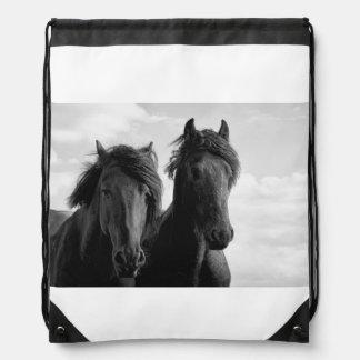Two Friesian stallions. Drawstring Bag