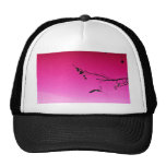 two geese flying in pink sky mesh hats