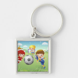 Two girls and a boy playing soccer key chain