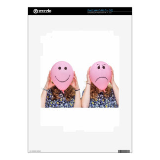 Two girls hold pink balloon with facial expression skins for the iPad 2