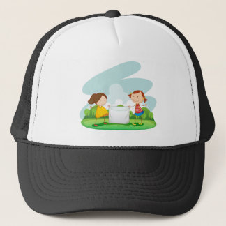 Two girls holding cloth in the park trucker hat