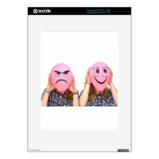 Two girls holding pink balloons with expressions decal for the iPad