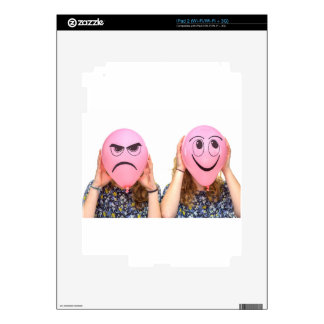 Two girls holding pink balloons with expressions iPad 2 skins