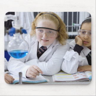 Two girls in school uniform wearing lab coats mouse pad