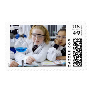 Two girls in school uniform wearing lab coats postage