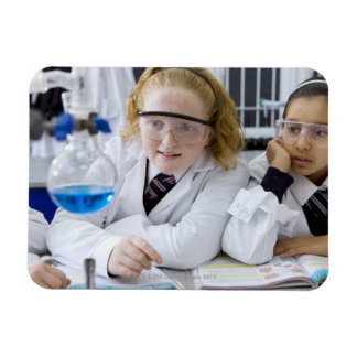 Two girls in school uniform wearing lab coats rectangular magnets