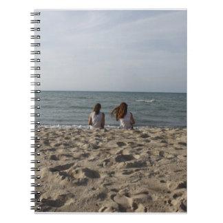 Two Girls on Sandy Beach: 2 Girls Face Windy Ocean Notebook