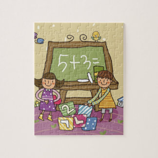 Two girls standing in front of a blackboard jigsaw puzzle