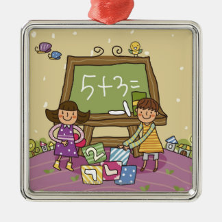 Two girls standing in front of a blackboard metal ornament