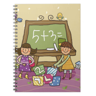 Two girls standing in front of a blackboard notebook