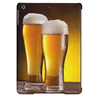 Two glasses of beers on a wooden table iPad air case