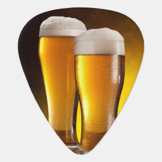 Two glasses of beers on a wooden table guitar pick
