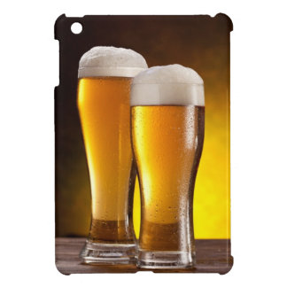 Two glasses of beers on a wooden table iPad mini cases