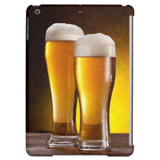 Two glasses of beers on a wooden table iPad air cover