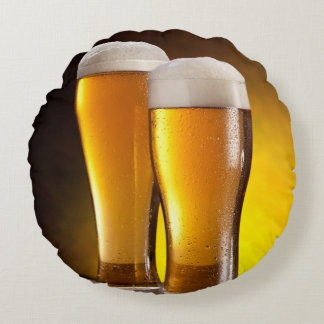 Two glasses of beers on a wooden table round pillow