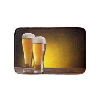 Two glasses of beers on a wooden table bath mats