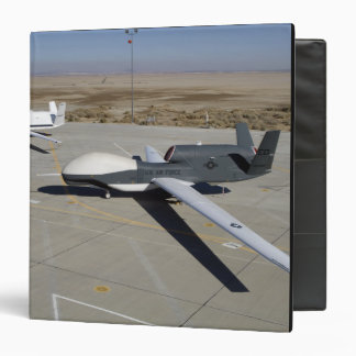 Two Global Hawks parked on a ramp Binder