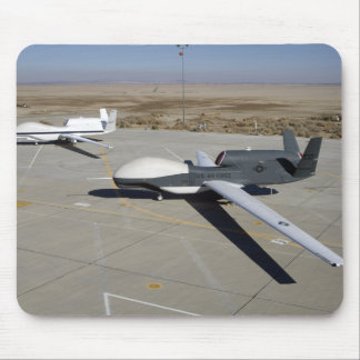 Two Global Hawks parked on a ramp Mouse Pad