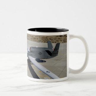 Two Global Hawks parked on a ramp Coffee Mug
