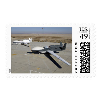 Two Global Hawks parked on a ramp Postage