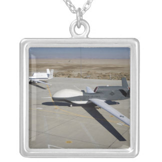 Two Global Hawks parked on a ramp Square Pendant Necklace