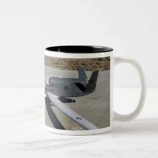 Two Global Hawks parked on a ramp Two-Tone Coffee Mug
