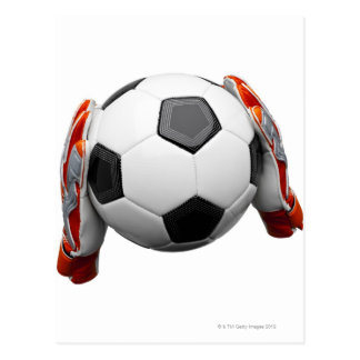 Two goal keepers gloves holding a football postcard