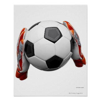 Two goal keepers gloves holding a football posters