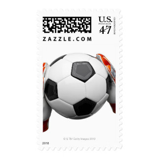 Two goal keepers gloves holding a football stamp
