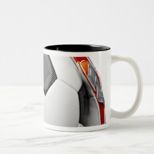 Two goal keepers gloves holding a football Two-Tone coffee mug