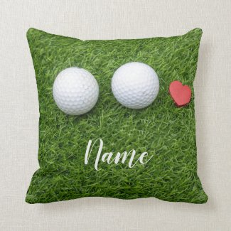 Two Golf balls and  love heart are on green grass Throw Pillow