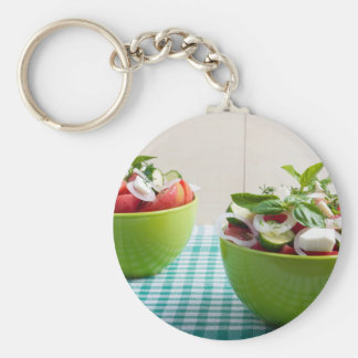Two green bowl with vegetable vegetarian salad keychain