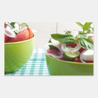 Two green bowl with vegetable vegetarian salad rectangular sticker