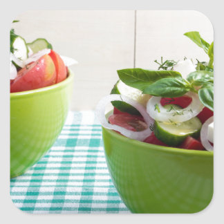 Two green bowl with vegetable vegetarian salad square sticker